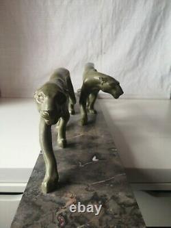 Grande sculpture Art-Déco de deux Panthères en fonte d'art signée M FONT