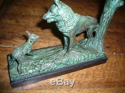 Rare paire de serre livres Art déco en bronze signés Max Leverrier (1891-1973)